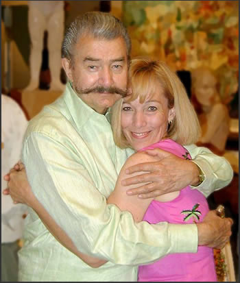 LeRoy Neiman hugs Neiman Originals owner Carla Bonney.